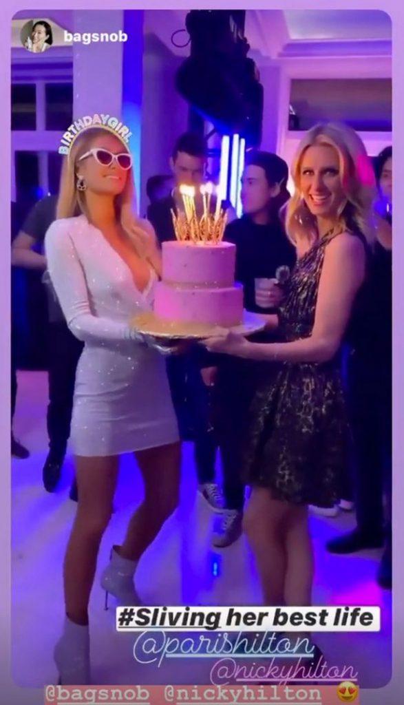Paris Hilton with birthday cake Sliving