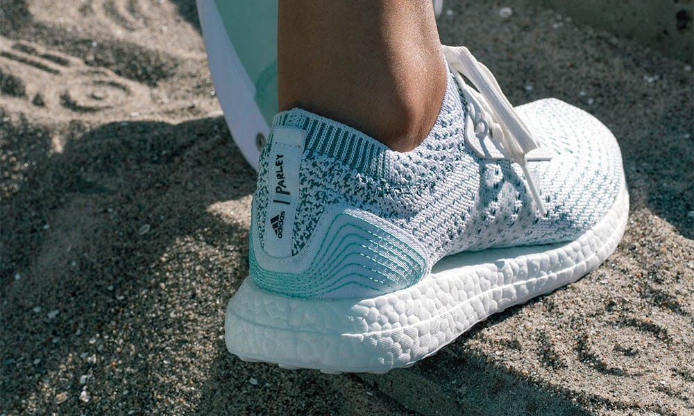 white sporty trainer by Adidas x Parley