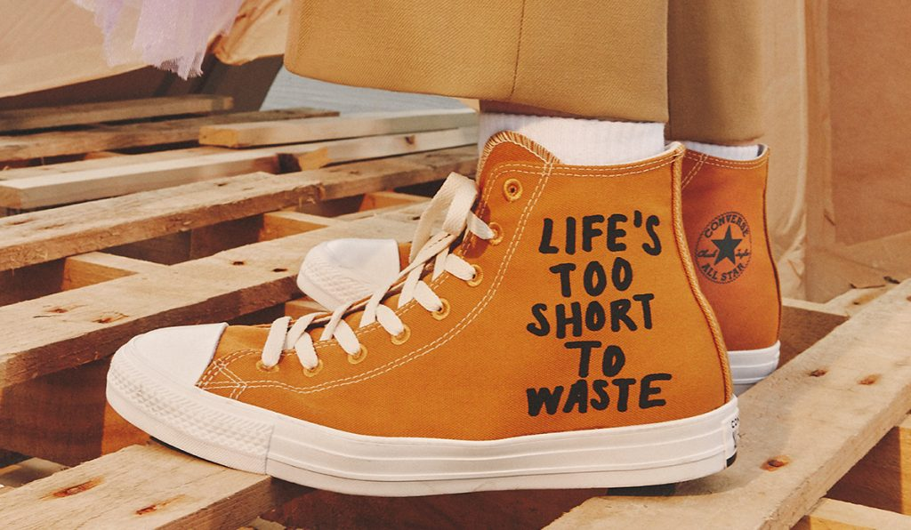 converse renew orange trainer with slogan life's too short
