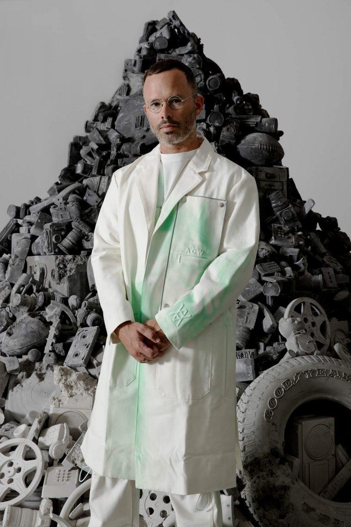 Daniel Arsham in front of sculpture props
